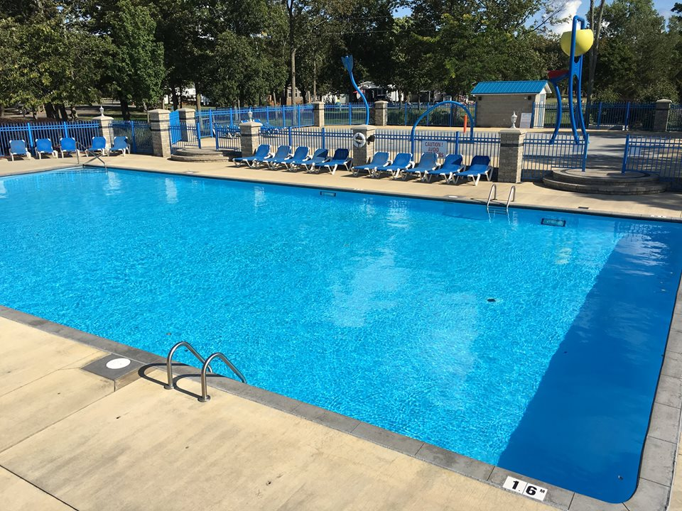 Gleaming water of community pool surrounded by lounge chairs