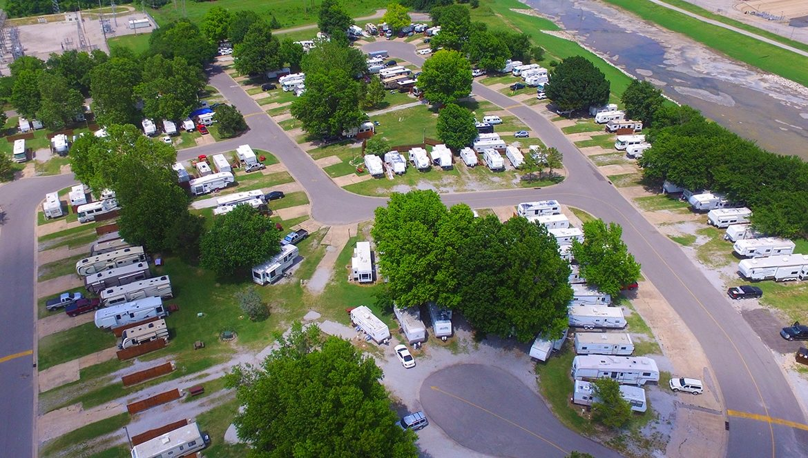 Aerial view of many RVs parked along road