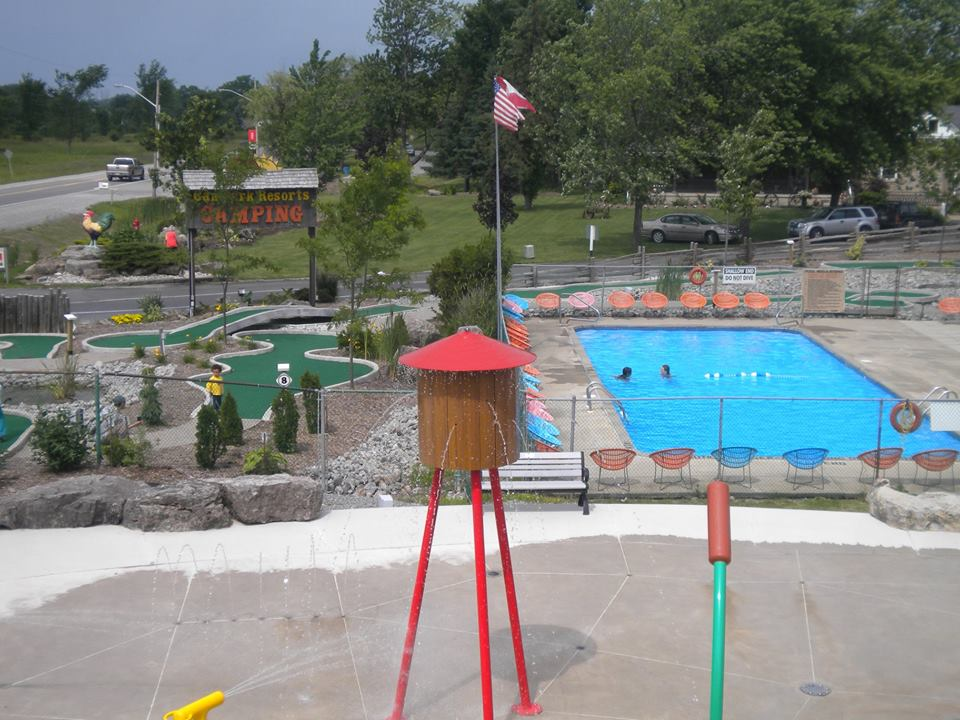 Aerial view of mini golf course alongside community pool.