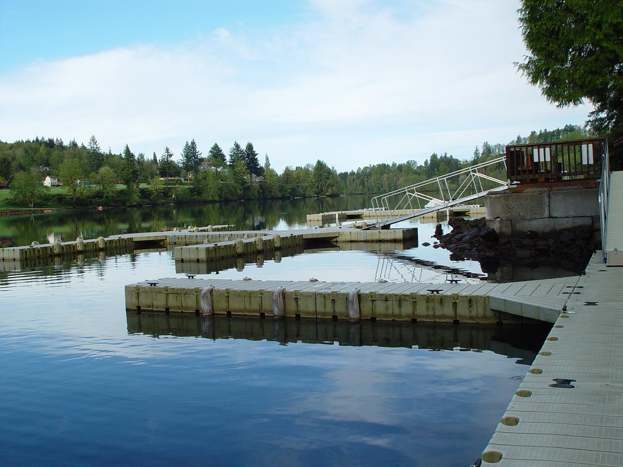 Wooden boat docks on glassy calm lake