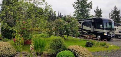 Large RV in spot alongside beautiful landscaping