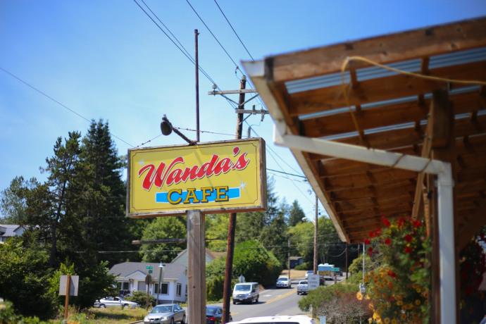 Sign reading Wanda's Cafe in small town
