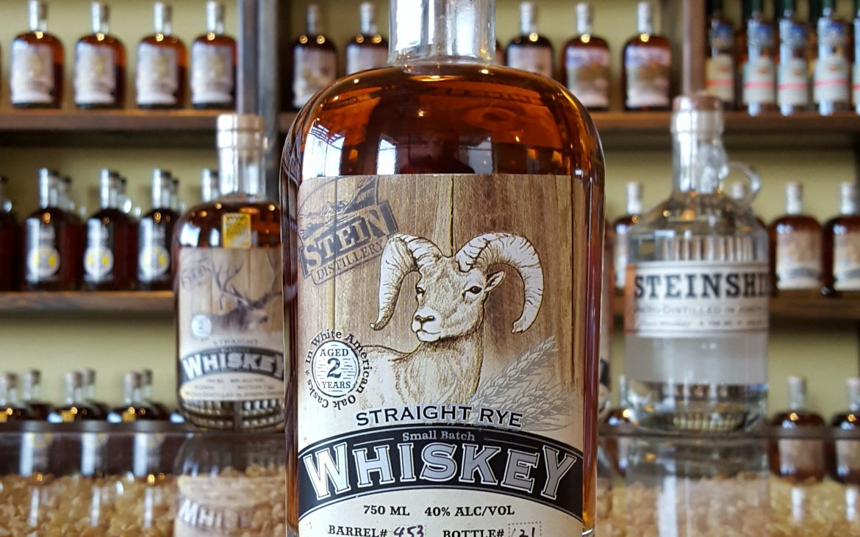 Bottle of whiskey on bar at distillery