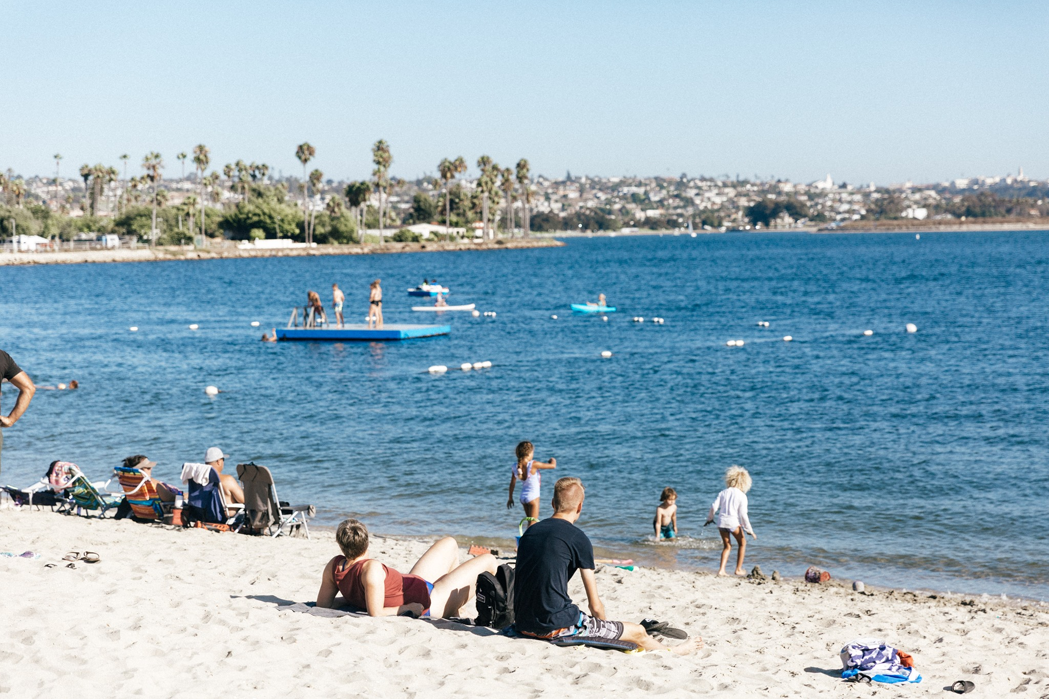 People relaxing on the beach in San Diego