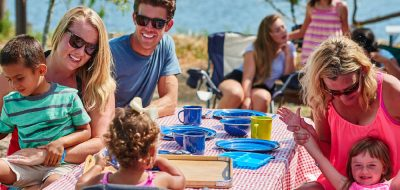 Large family at picnic table on the water