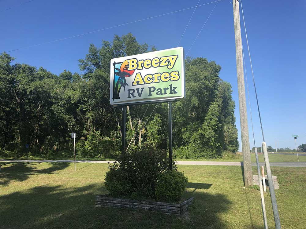 Breezy Acres RV Park Sign welcomes visitors to a lush, green RV park.