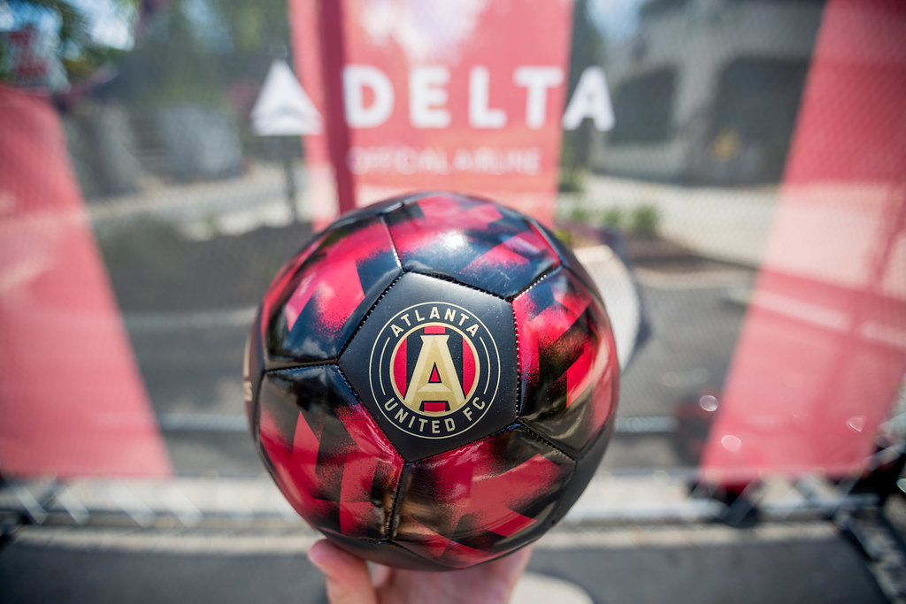 red and black soccer ball