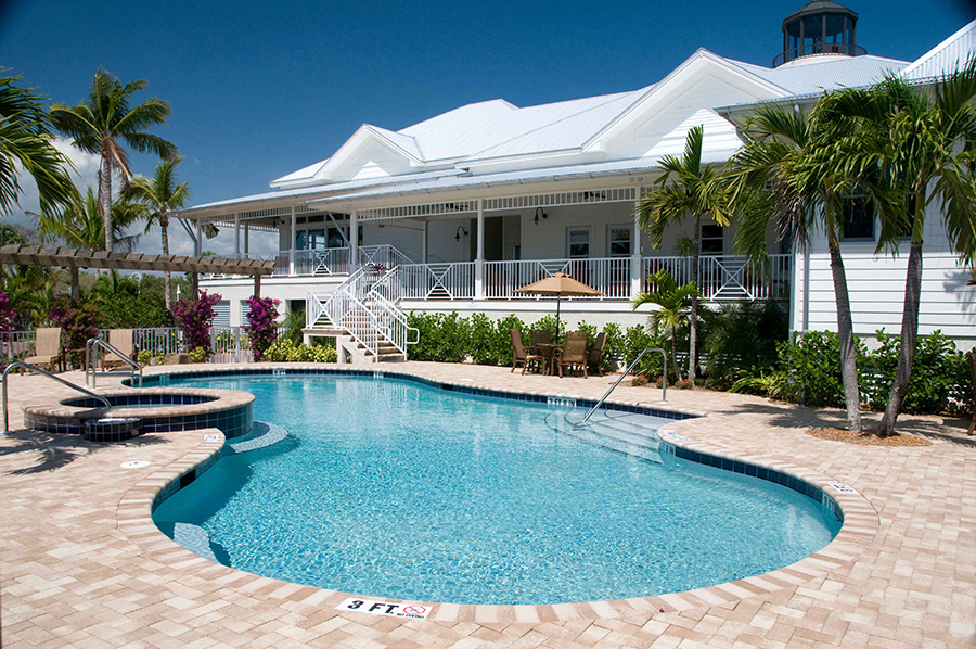 A pool shimmers in the sun at Everglades Isle Motorcoach Resort & Marina.