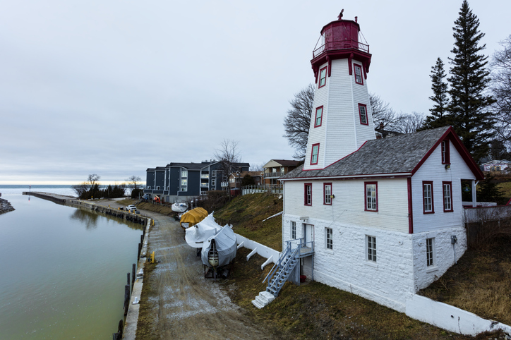White and red lighthouse on the water
