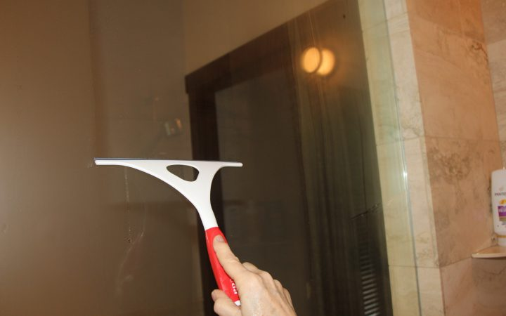 A squeegee used to clear the glass of an RV shower stall.