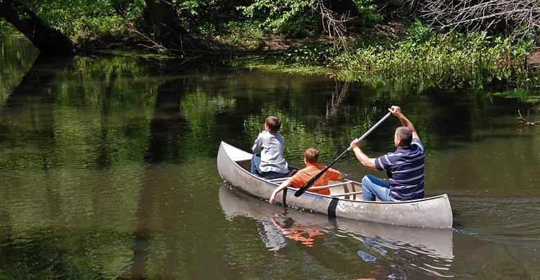 Family kayaking down river