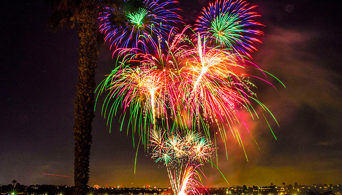 Colorful fireworks display over Newport Beach ocean at night