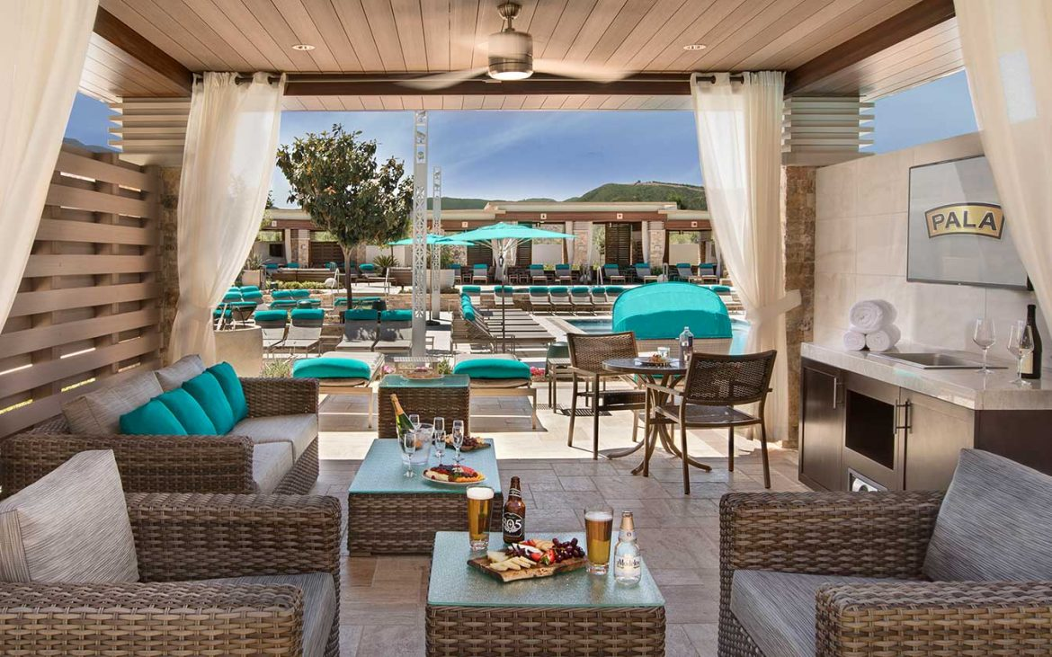 Beautiful outdoor seating area under cabana, near pool