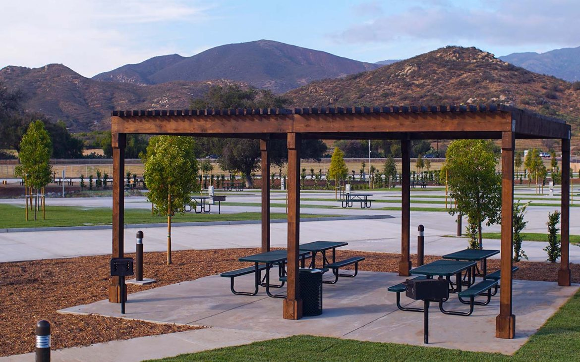 Park benches under wood patio cover at RV park