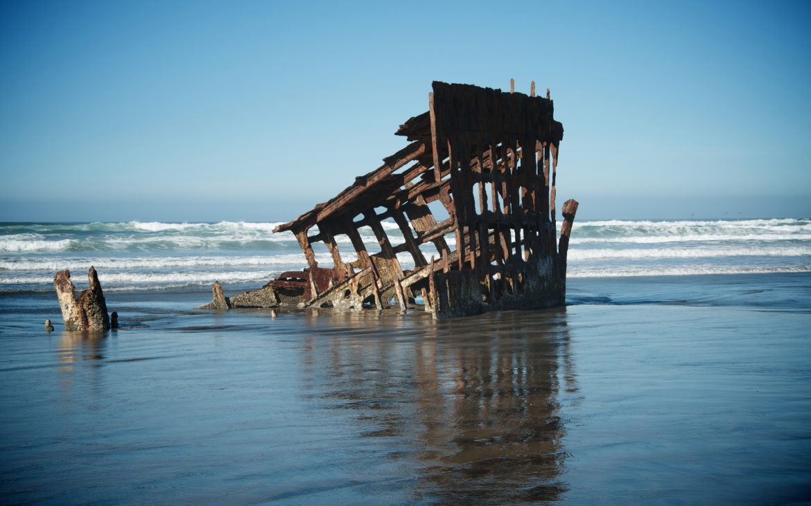 Shipwreck in ocean waves of Oregon