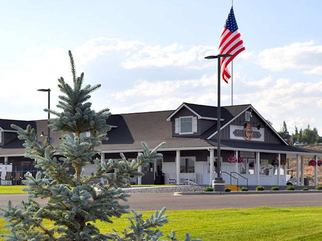 Large cottage style building with American Flag