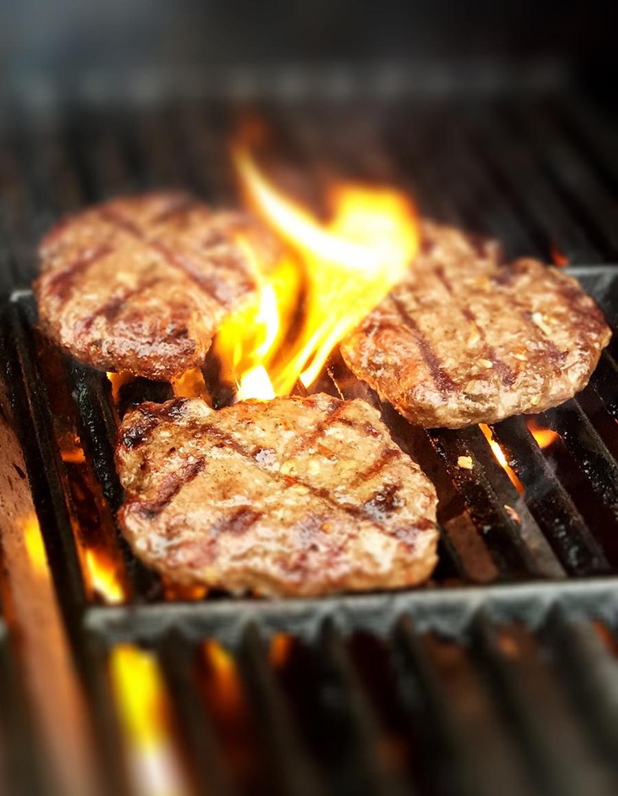 3 Burgers on an open fire