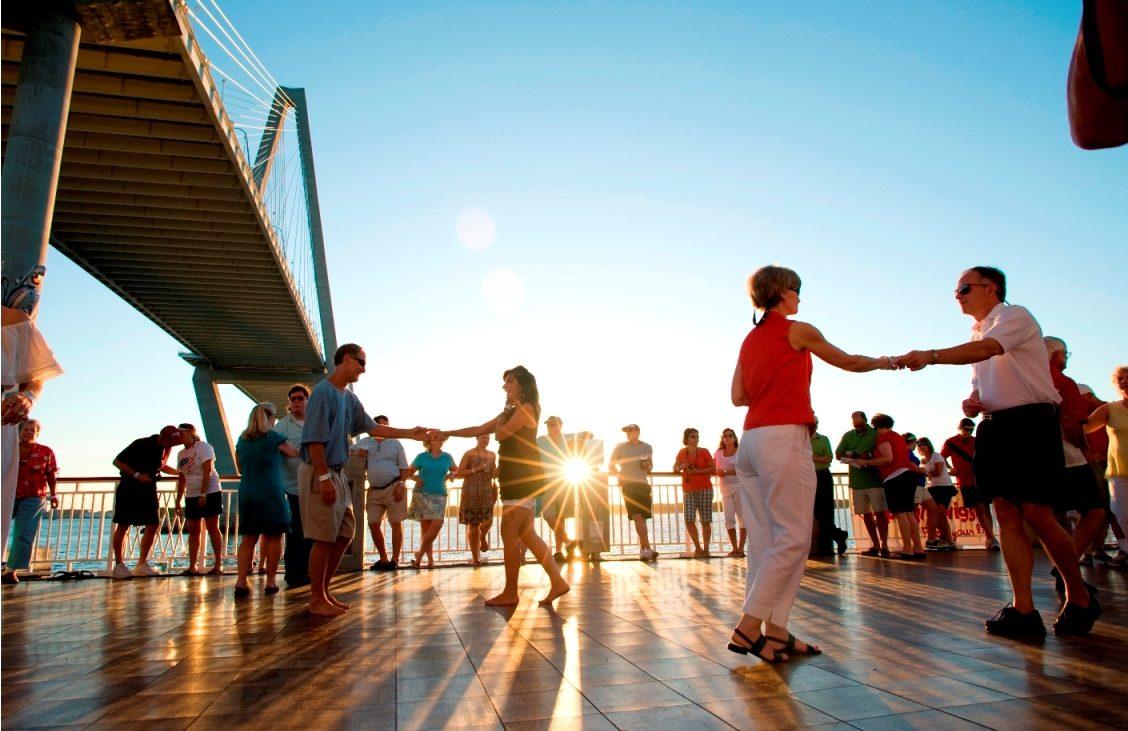 People dancing on outdoor dance floor during day