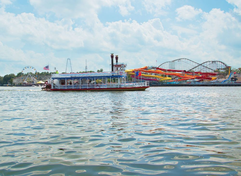 Boat on the water with ride in background