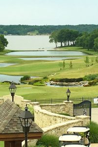 Winding walkway toward golf course greens on the water