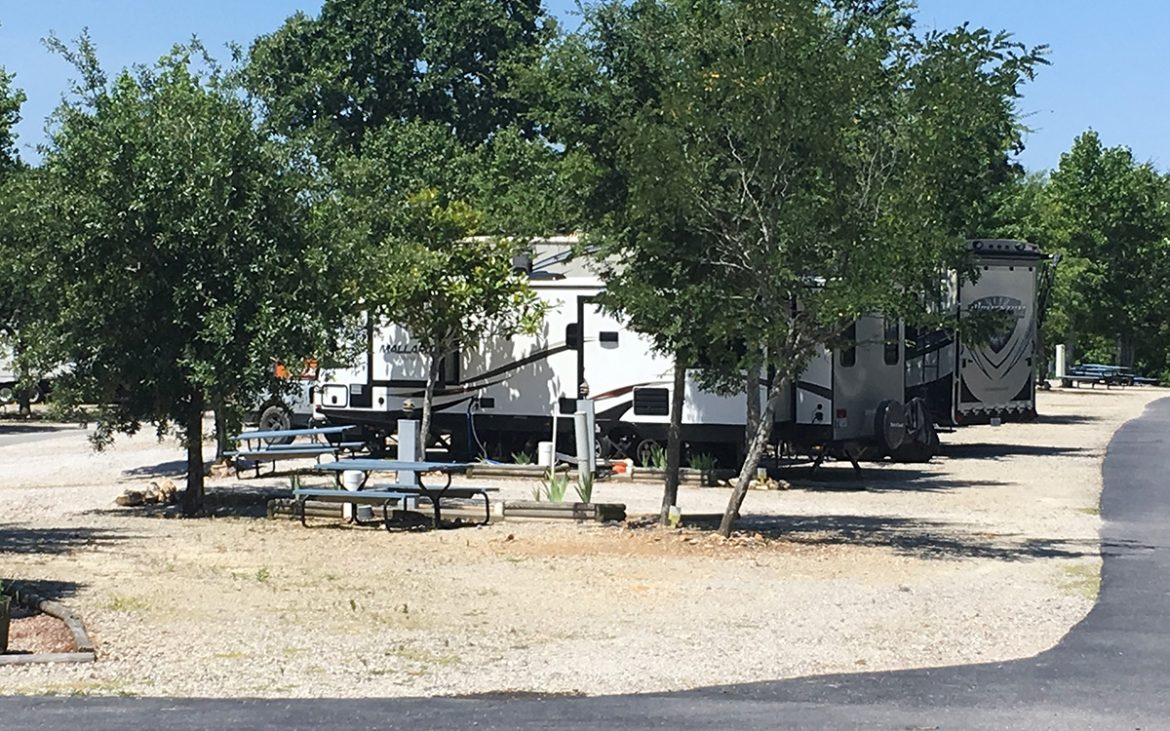 Trailers parked in dirt spots