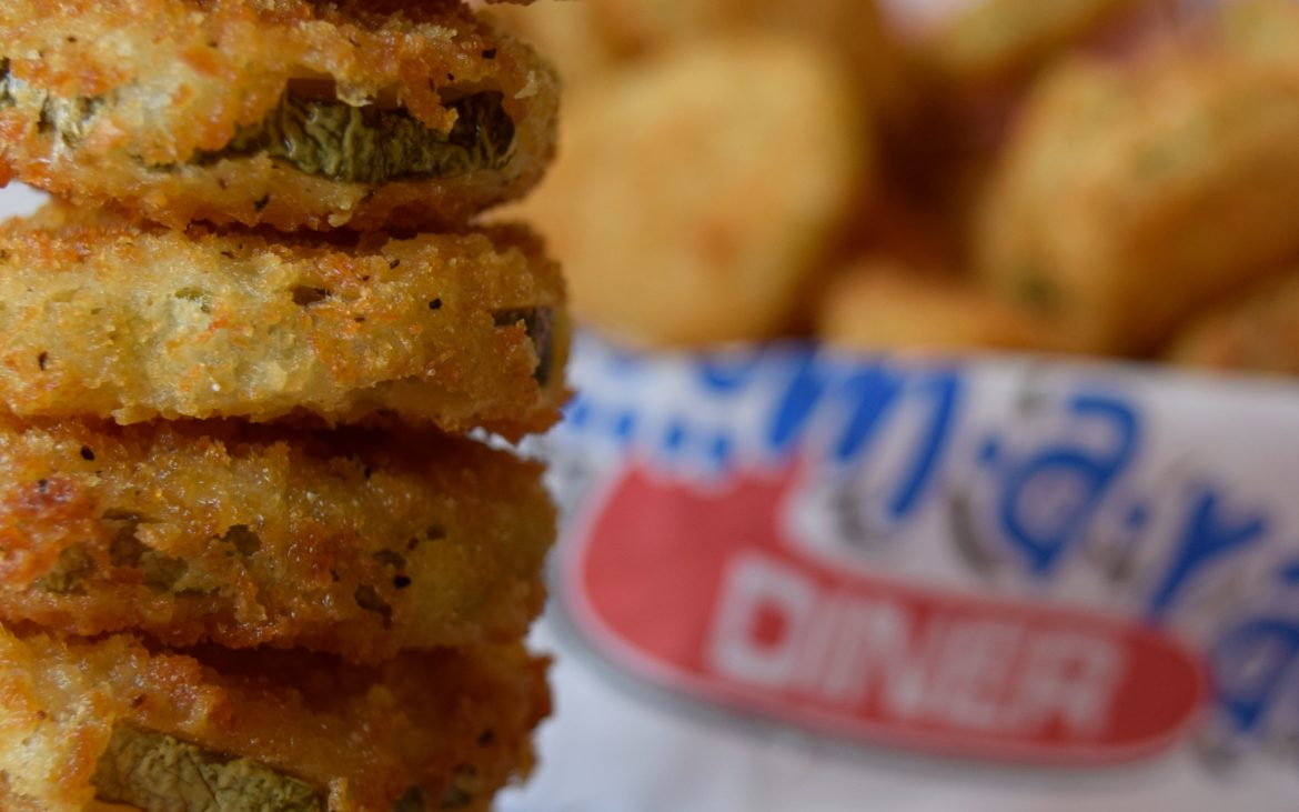 Stacked onion rings cooked to golden color