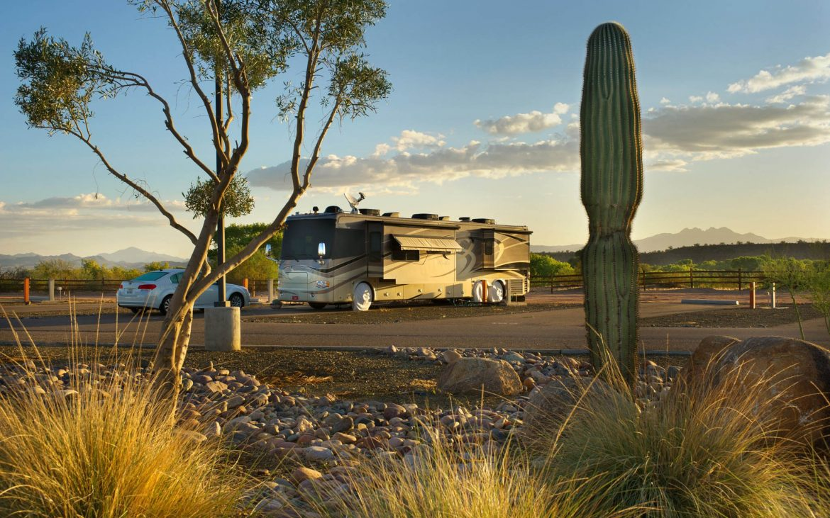 large RV parked along desert landscape