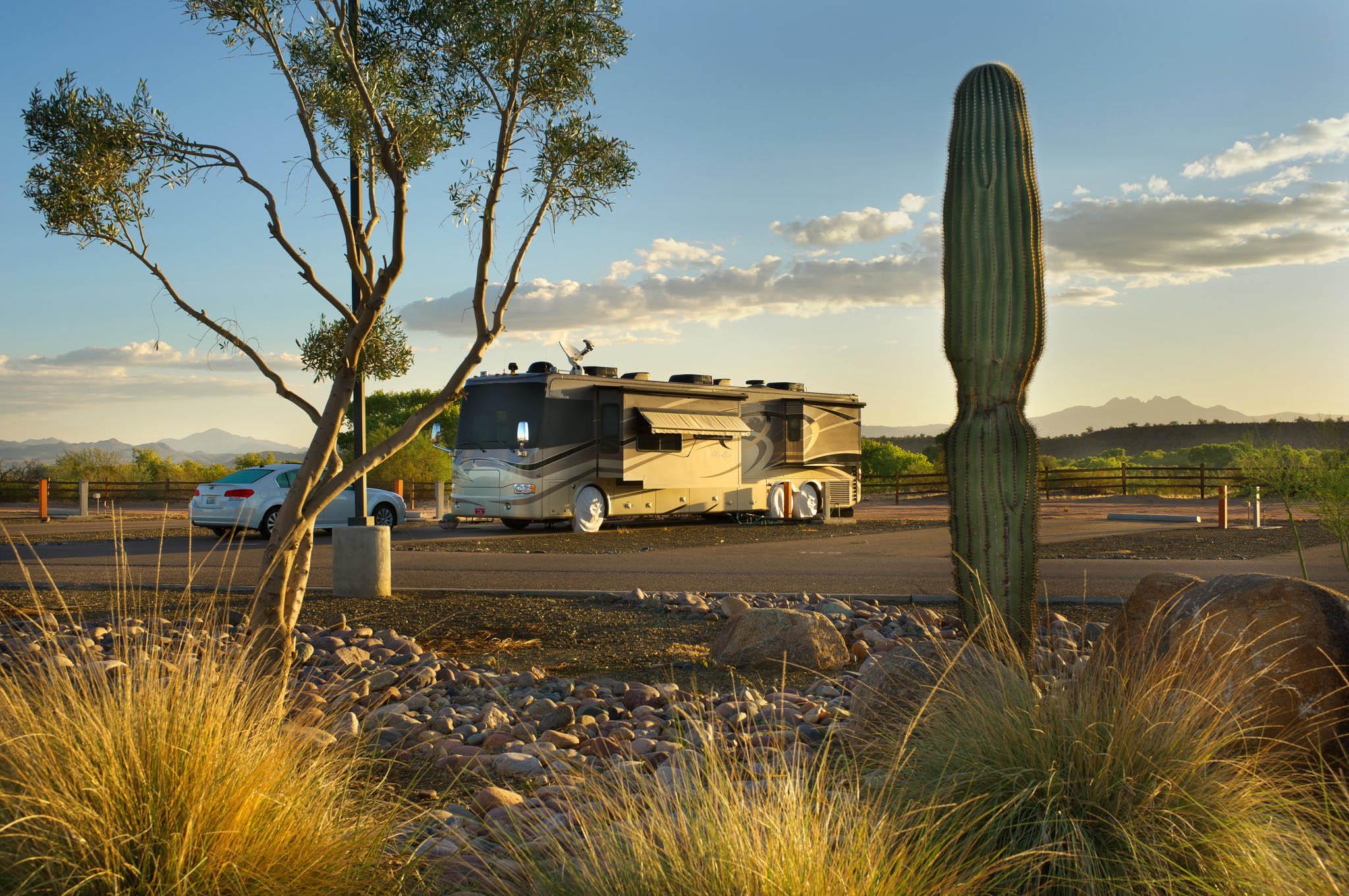 large RV parked along desert landscape
