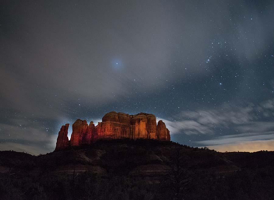 Cathedral Rock looms against the night sky for hiking in the American Southwest.