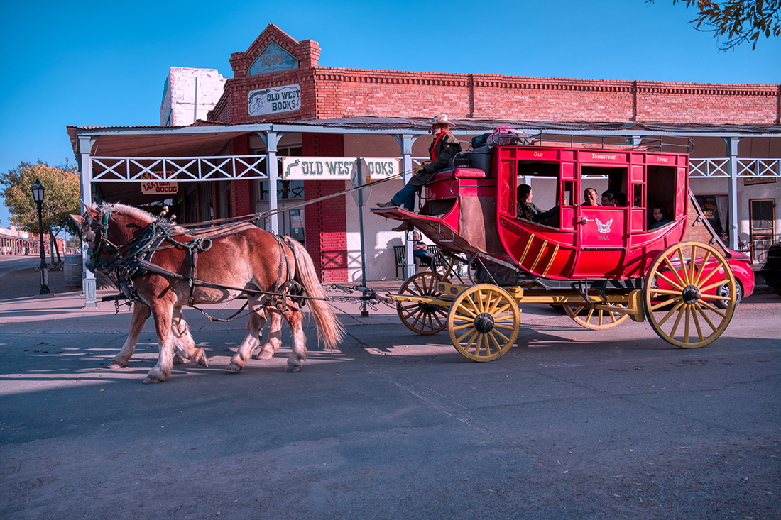A bright red stagecoach rumbles through Tombstone, Arizona.