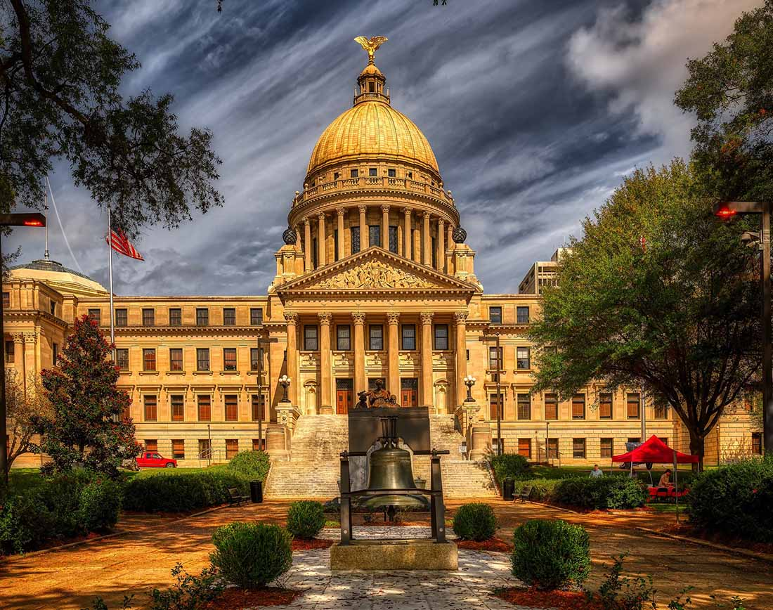 The Mississippi state capitol's dome shines in the sunlight.
