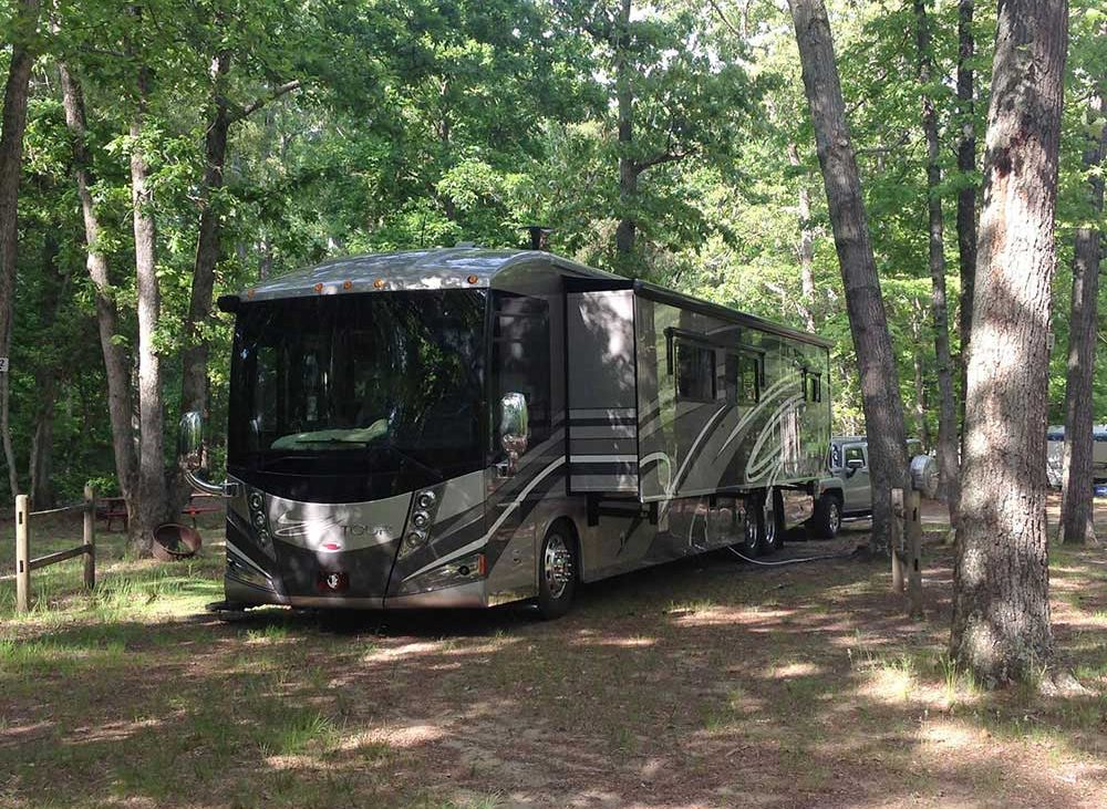 Large RV parked in the woods