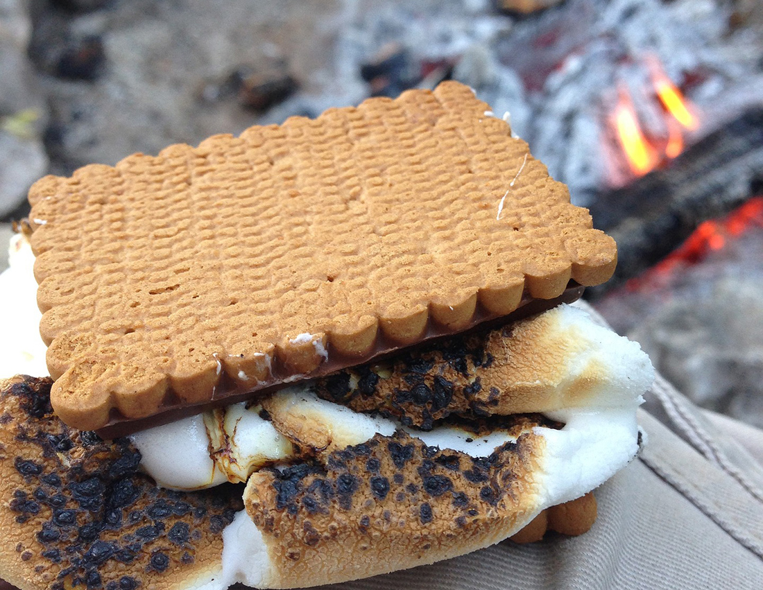 Molten marshmallow cools between two pieces of graham cracker.
