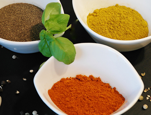 Three bowls filled with an array of spices for extra flavor.