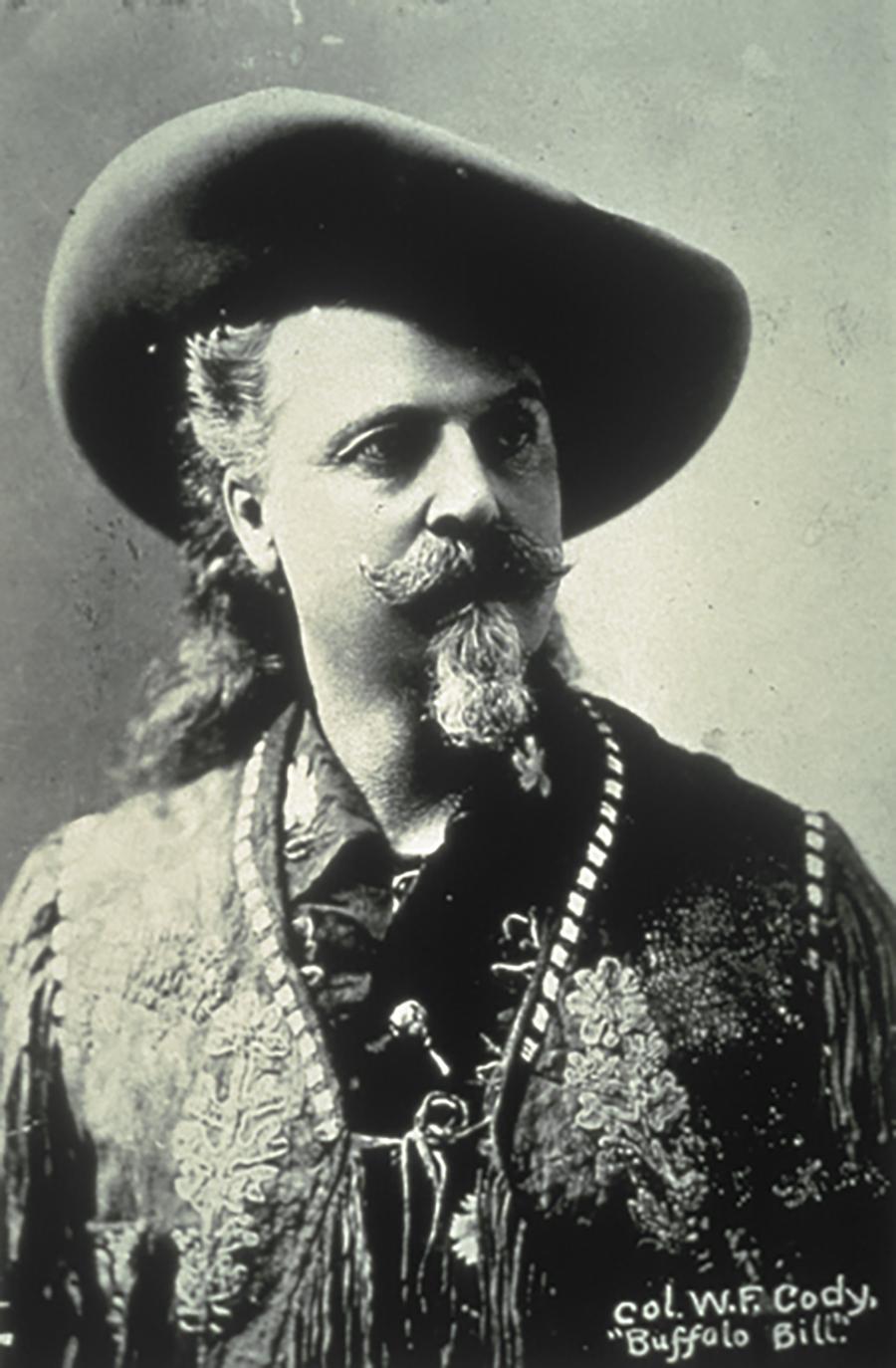 A vintage sepia-toned headshot of Buffalo Bill in his signature buckskin and fringe.