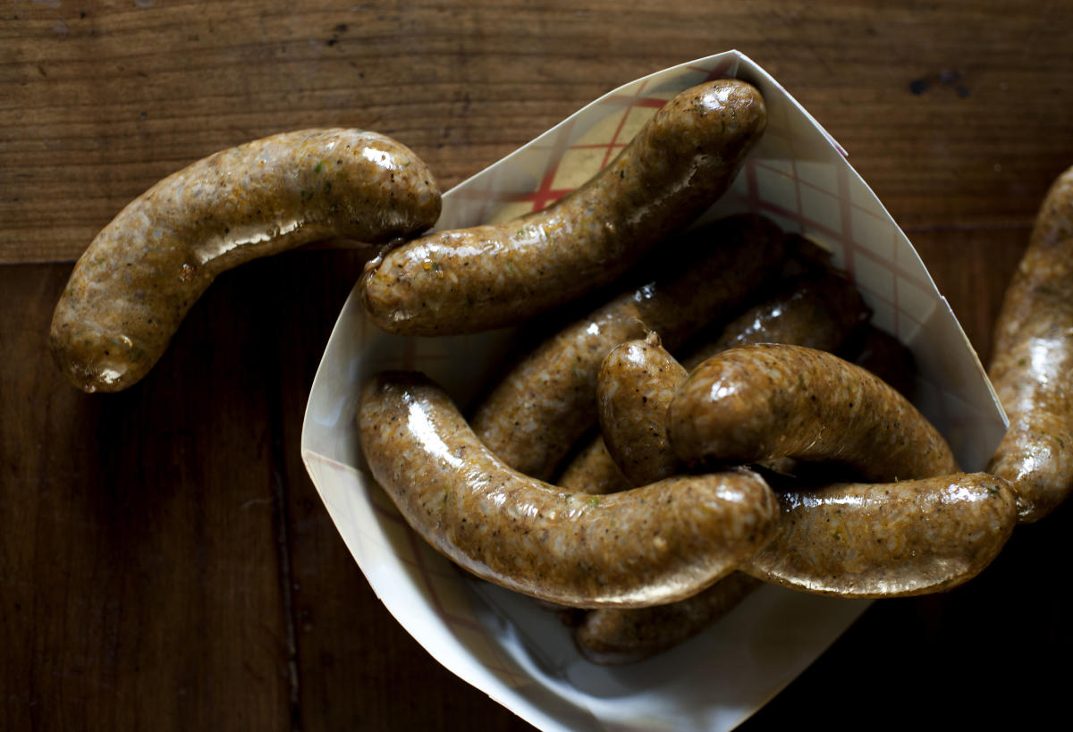 Boudin consists of pork sausage stuffed with rice, green onions and seasonings.