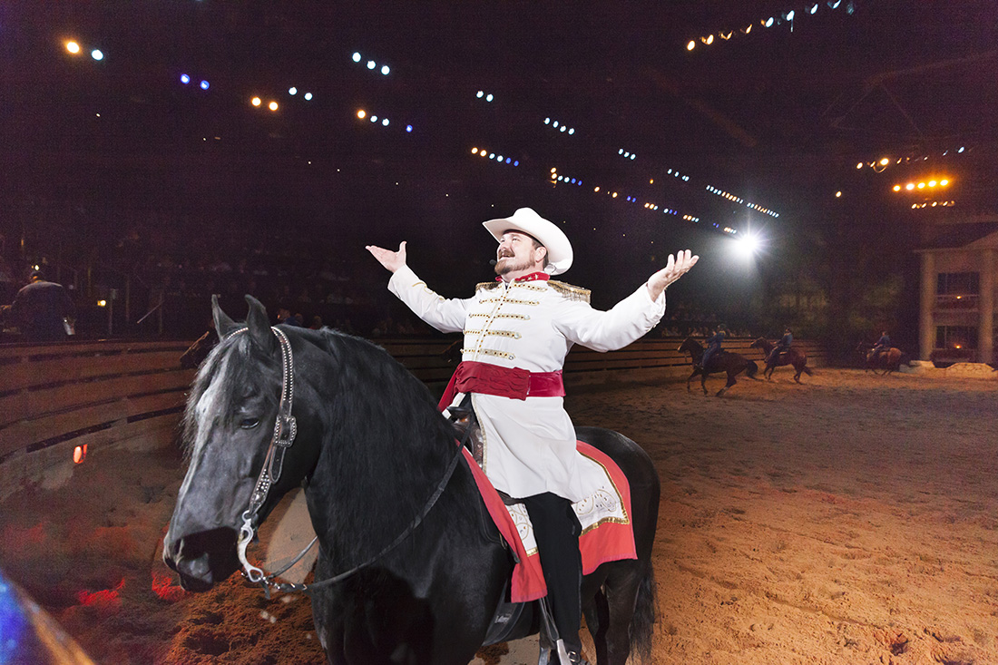 A man on horseback dressed in a Civil War uniform greets the crowd during a Branson performance.