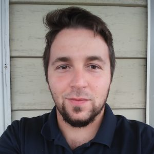 Man with goatee beard in headshot