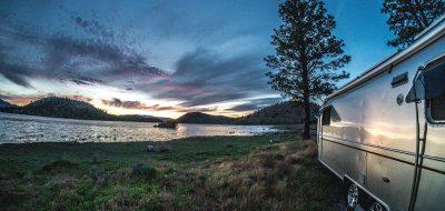 Airstream Trailer on lakeshore.