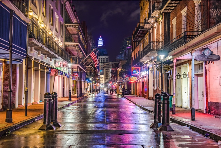Evening lights reflecting off wet street in New Orleans