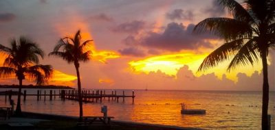 A golden sunset over a tropical beach in the Florida Keys.