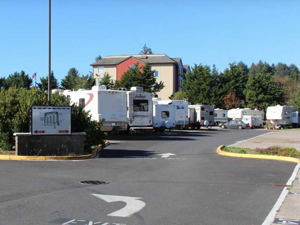 RVs at their sites amid tall, treen trees in Logan Road RV Park in Oregon.
