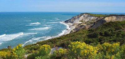 The cliffs of Aquinnah in Martha's Vineyard tower over the blue ocean.
