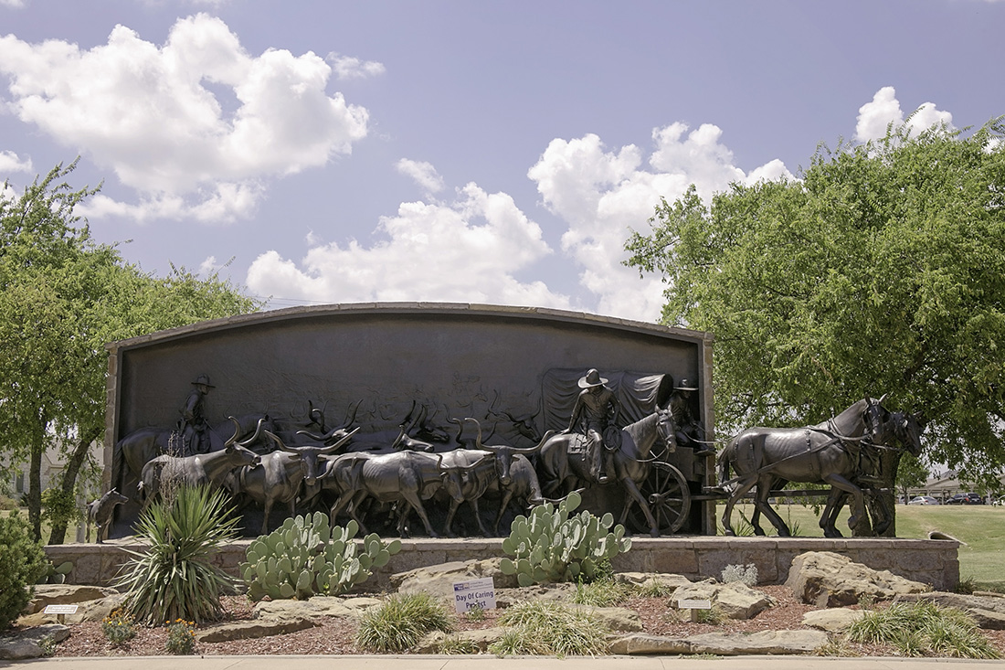 A sculpture depicts that challenges faced by cowboys in the 1800s.