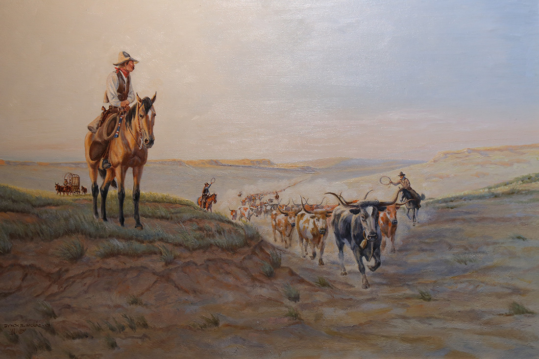 Paintings depicting the rough life of a cowboy are on display in the Garis Gallery.