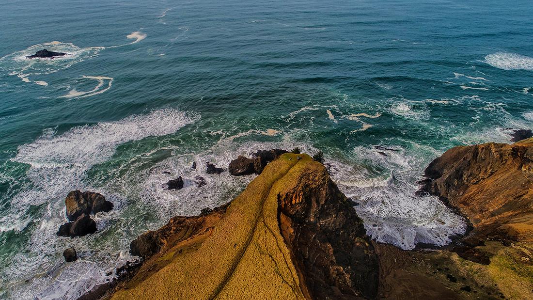 A tall rock outcropping overlooks the roiling ocean near Logan Road RV Park in Oregon.