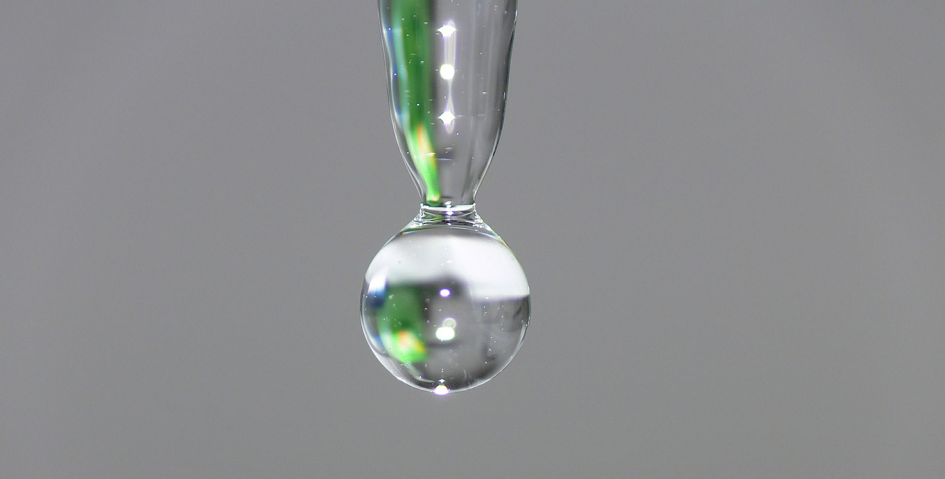 A closeup of water dripping through space.