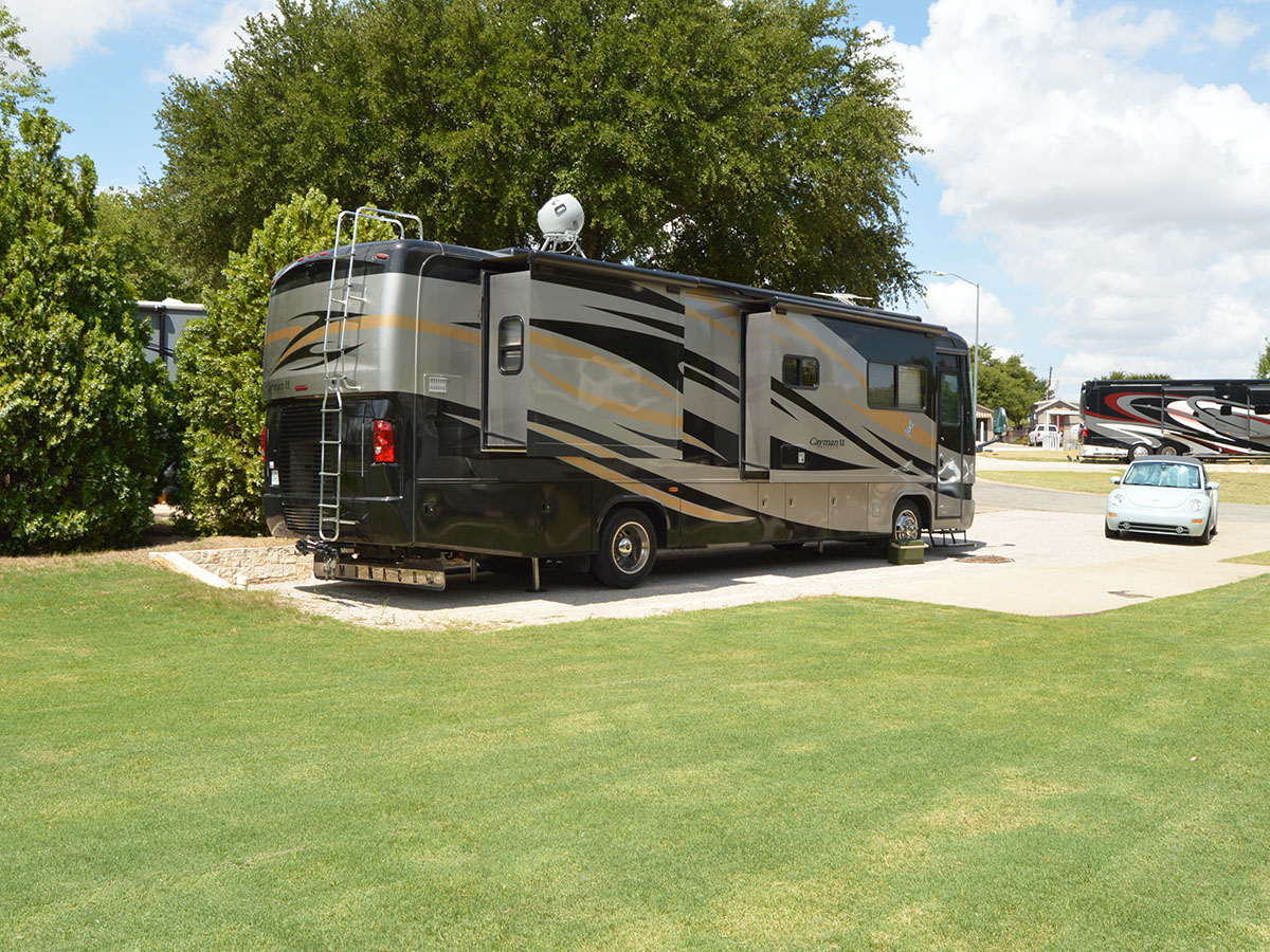 RV Parked in a roomy site.