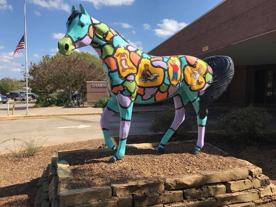 A painted horse greets visitor to Shawnee.