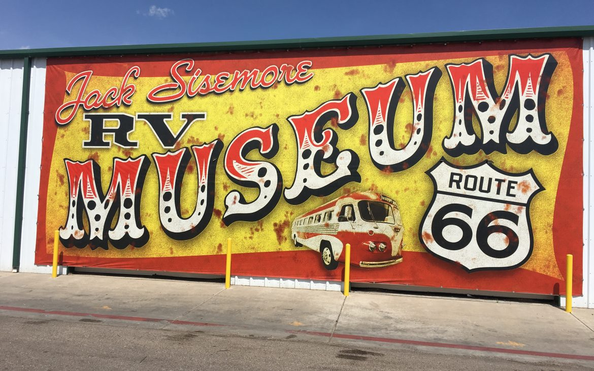 LArge RV Museum sign on side of building